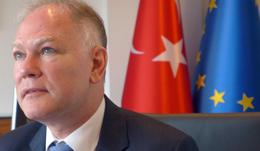Turkey's Ambassador to the European Union Selim Yenel speaks during an interview at the Turkish embassy in Brussels on Thursday, Aug. 11, 2016. Yenel said on Thursday that Ankara could be willing to modify its anti-terror law if the changes do not impede the fight against terrorism and if Turkish citizens are guaranteed visa free travel in Europe in coming months. (AP Photo/Lorne Cook)