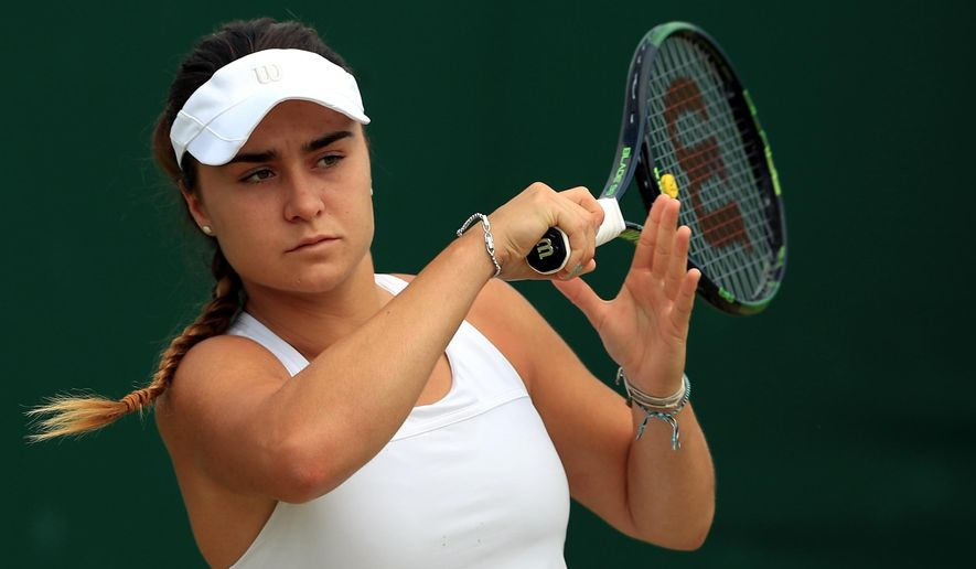 FILE - This is a July 2016 file photo of of  rising British tennis star Gabriella Taylor in action at Wimbledon London. British police are investigating allegations that Taylor a player at the Wimbledon tennis tournament was poisoned, after she fell ill with a bacterial infection that can be spread through rat urine. Gabriella Taylor was playing in the junior tournament when she became sick . (John Walton/PA, File via AP)