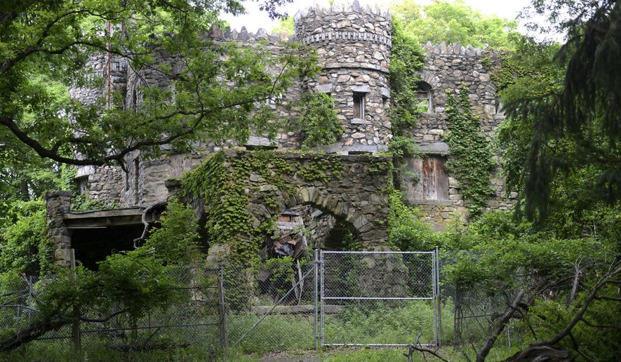 In this Thursday, June 30, 2016 photo, Hearthstone Castle is overgrown with foliage in Danbury, Conn. The city is planning to demolish the castle, a landmark listed on the National Register of Historic Places, that was built in 1899 and has fallen into disrepair. (Tyler Sizemore/Hearst Connecticut Media via AP)