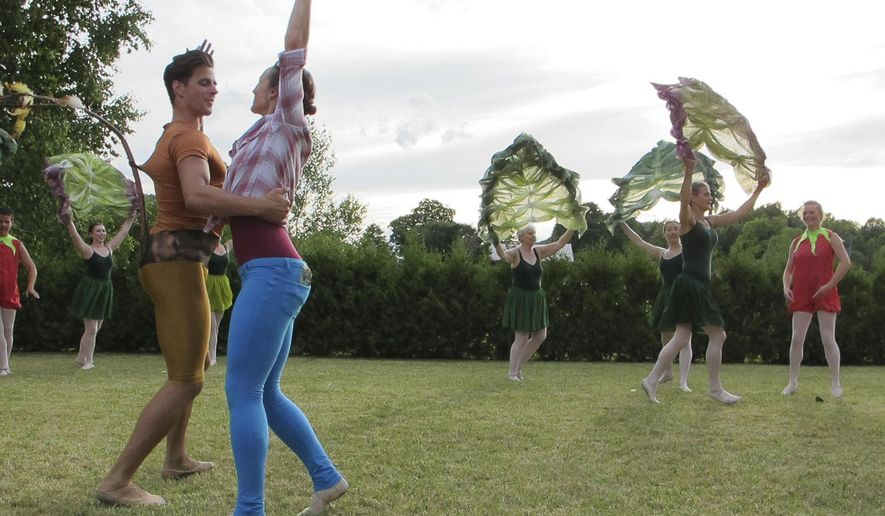 In this July 16, 2016 photo, members of the Farm to Ballet Project perform at Philo Ridge Farm in Charlotte, Vt. The ballet group is performing at farms around Vermont for its second summer season to raise money for local agriculture and increase the audience for classical ballet. (AP Photo/Lisa Rathke)