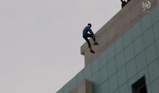 """A new video purportedly released by the Islamic State terrorist group showed a man accused of """"homosexual acts"""" being pushed off the roof of a tall building as children watched."""