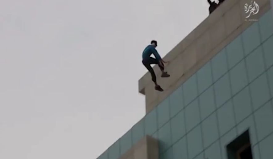"A new video purportedly released by the Islamic State terrorist group showed a man accused of ""homosexual acts"" being pushed off the roof of a tall building as children watched."