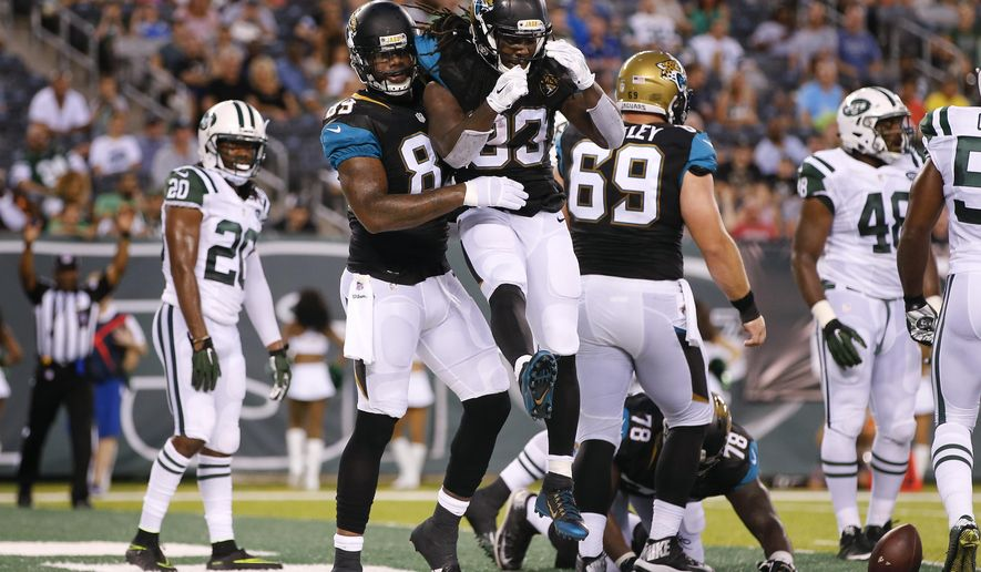 Jacksonville Jaguars running back Chris Ivory (33) celebrates with tight end Marcedes Lewis (89) after scoring a touchdown against the New York Jets during the first quarter of an NFL football game, Thursday, Aug. 11, 2016, in East Rutherford, N.J. (AP Photo/Kathy Willens)