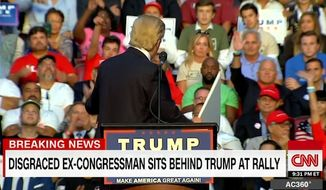 Disgraced ex-Congressman Mark Foley was spotted sitting behind Donald Trump at a Florida rally Wednesday. He's seen to Mr. Trump's right wearing a black blazer and red shirt, raising his right hand. (CNN)