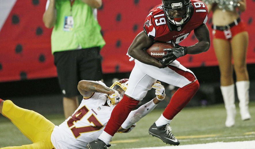 Atlanta Falcons wide receiver Aldrick Robinson (19) breaks the tackle of Washington Redskins cornerback Quinton Dunbar (47) during the first half of a preseason NFL football game, Thursday, Aug. 11, 2016, in Atlanta. (AP Photo/John Bazemore)