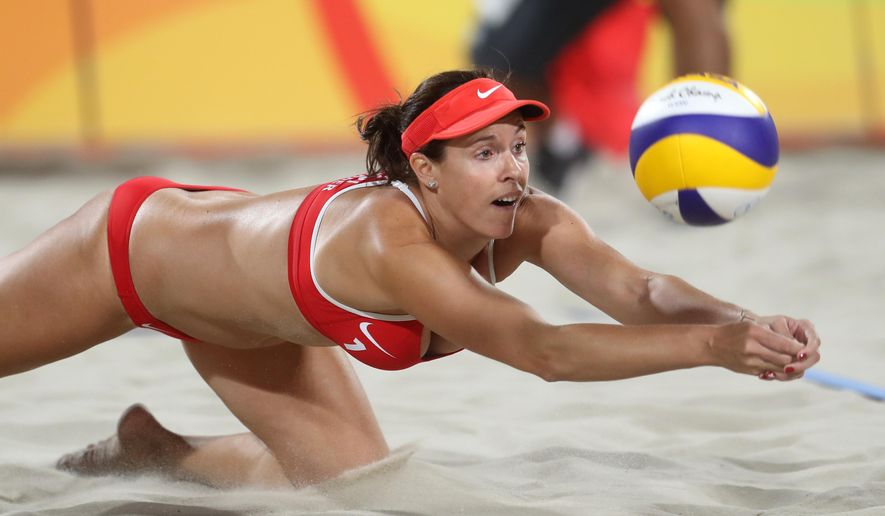 FILE - In this Saturday, Aug. 6, 2016, file photo, Switzerland's Isabelle Forrer dives for a ball during a women's beach volleyball match against China at the 2016 Summer Olympics in Rio de Janeiro. NBC and other television networks around the world are offering selected Olympic events, which included the women's beach volleyball match between Switzerland and China, in virtual reality for the first time, but television remains the go-to place for a truly immersive experience. (AP Photo/Petr David Josek, File)