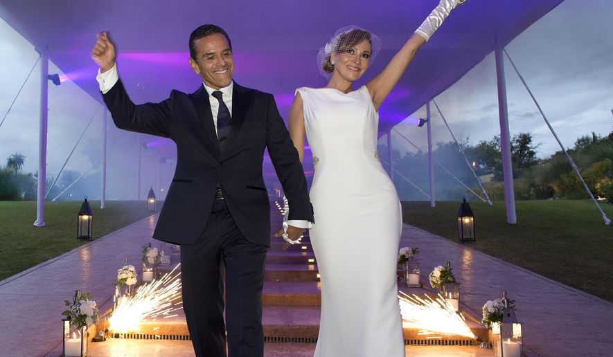 This Saturday, Aug. 6, 2016 photo shows former Los Angeles Mayor Antonio Villaraigosa during his wedding to Patricia Govea at a private ceremony and reception in San Miguel de Allende, Mexico. Villaraigosa, a potential candidate for governor, tied the knot with Govea in a ceremony in central Mexico, with about 100 friends and family in attendance. (Armando Arorizo/WeddingVignette.com via AP)