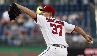 Washington Nationals starting pitcher Stephen Strasburg throws during the first inning of a baseball game against the Atlanta Braves at Nationals Park, Friday, Aug. 12, 2016, in Washington. (AP Photo/Alex Brandon)