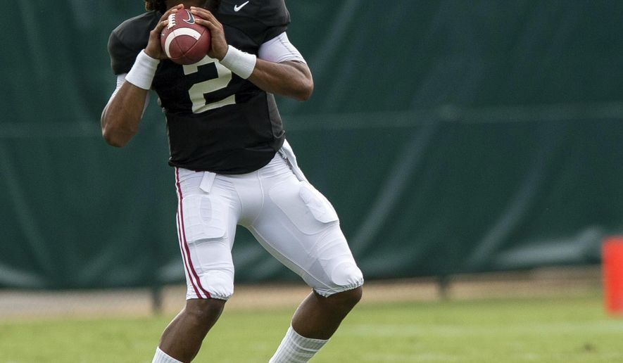 In this Monday, Aug. 8, 2016 photo, Alabama quarterback Jalen Hurts throws during NCAA college football practice, , at the Thomas-Drew Practice Fields in Tuscaloosa, Ala. (Vasha Hunt/AL.com via AP)