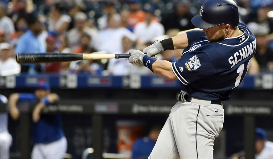 San Diego Padres' Ryan Schimpf hits a grand slam off of New York Mets starting pitcher Logan Verrett in the first inning of a baseball game, Friday, Aug. 12, 2016, in New York. (AP Photo/Kathy Kmonicek)