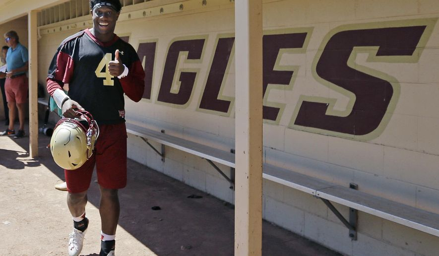 Boston College quarterback Darius Wade gives a thumbs up after football practice, Monday, Aug. 8, 2016, in Boston. (AP Photo/Elise Amendola)