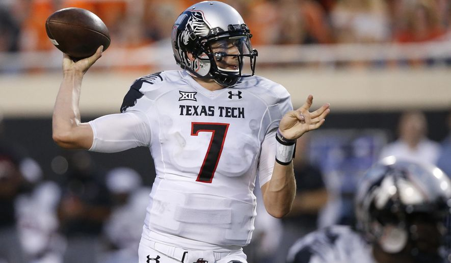 In this Sept. 25, 2014 photo, former Texas Tech quarterback Davis Webb (7) is pictured during an NCAA college football game between Texas Tech and Oklahoma State in Stillwater, Okla. Webb, a graduate transfer, has been named the starting quarterback for California. (AP Photo/Sue Ogrocki)