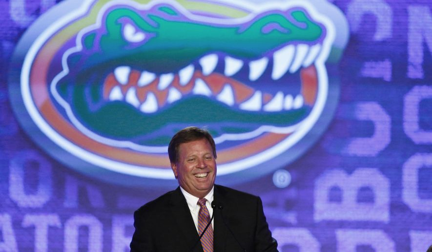 FILE - In this July 11, 2016, file photo, Florida coach Jim McElwain speaks to the media at the Southeastern Conference NCAA college football media days, in Hoover, Ala. McElwain's second season at Florida can't possibly have as many twists as his first. (AP Photo/Brynn Anderson, FIle)