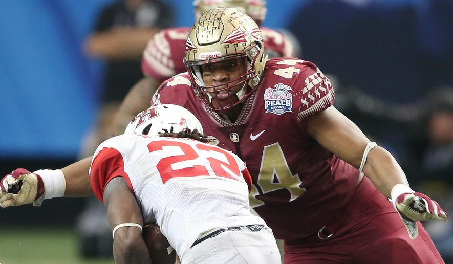 FILE- In this Dec. 31, 2016, file photo, Florida State defensive end DeMarcus Walker (44) prepares to hit Houston running back Ryan Jackson (22) during the second half of the Peach Bowl NCAA college football game, in Atlanta. With 17 starters returning, the spotlight was already on Florida State as one of the nations top teams. (AP Photo/John Bazemore, File)