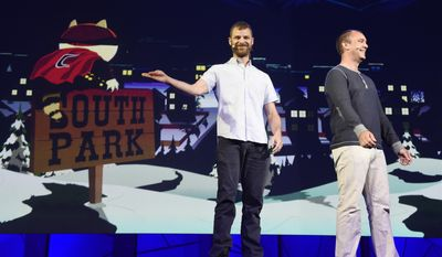 """In this June 15, 2015, file photo, """"South Park"""" creators Matt Stone, left, and Trey Parker discuss the """"South Park: The Fractured But Whole"""" video game onstage at Ubisoft's E3 2015 Conference at the Orpheum Theatre in Los Angeles. Ubisoft unveiled plans Friday, Aug. 12, 2016, for a VR mask that will pump fart smells into gamers' nostrils as they play """"South Park: The Fractured But Whole."""" (Photo by Chris Pizzello/Invision/AP, File)"""