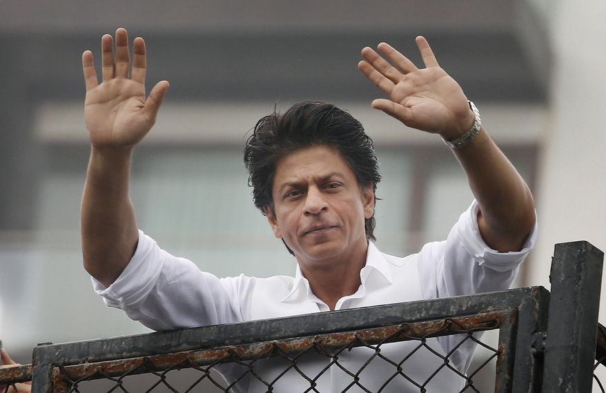 """FILE - In this Thursday, July 7, 2016, file photo, Bollywood actor Shah Rukh Khan greets fans waiting outside his residence on Eid al-Fitr in Mumbai, India. Bollywood superstar Khan has tweeted that he gets detained at U.S. airports """"every damn time"""" after he was stopped at the Los Angeles International Airport. The U.S. Ambassador to New Delhi Richard R. Verma tweeted an apology to the star Friday, Aug. 12, saying that the government was working to """"to ensure it doesn't happen again."""" (AP Photo/Rajanish Kakade, File )"""