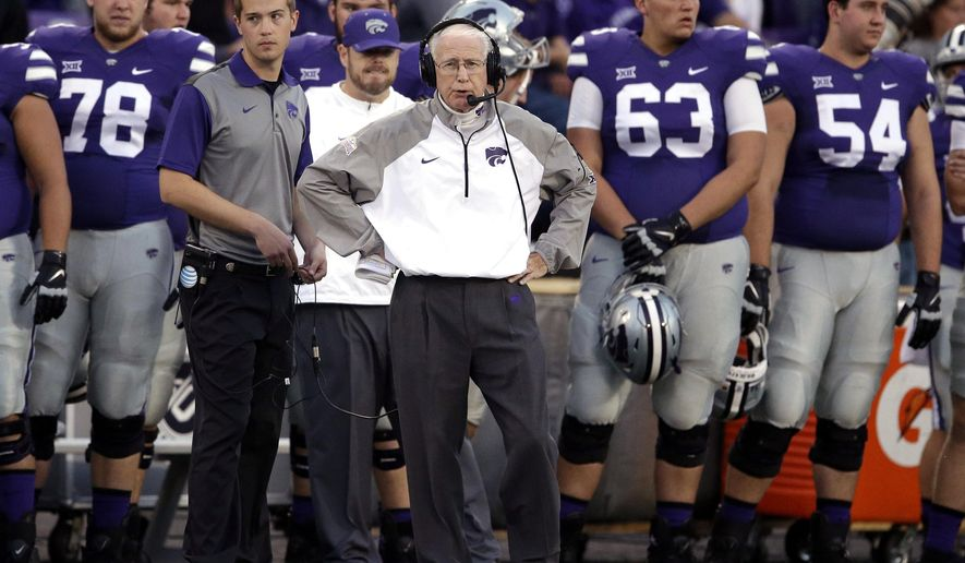 FILE - In this Oct. 10, 2015, file photo, Kansas State head coach Bill Snyder, center, stands with his team during the first half of an NCAA college football game against TCU in Manhattan, Kan. As the 76-year-old Snyder enters his 26th season, there are growing tremors that it may be his last. He needs seven wins to reach 200 for his career, a significant milestone, and the talent returning from an injury-plagued 2015 season means Kansas State could compete for another Big 12 title. (AP Photo/Orlin Wagner, File)