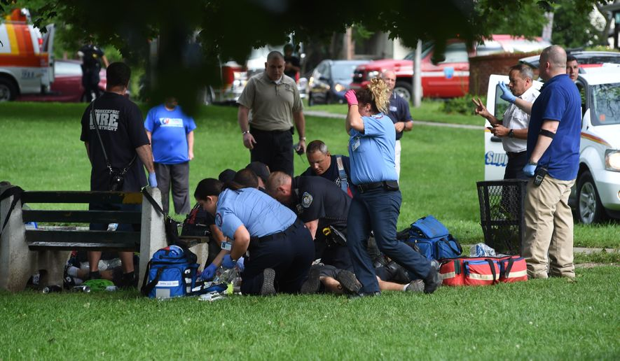 Emergency personnel put an unidentified victim possibly injured in a lightning strike onto a stretcher in Mansion Square Park in Poughkeepsie, N.Y., Friday, Aug. 12, 2016.  A city official says five people have been sent to hospitals with serious injuries after a powerful thunderstorm hit a Poughkeepsie park.   (Alex Wagner/The Journal via AP)