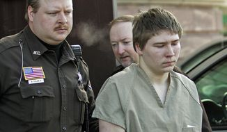 """Brendan Dassey, 16, is escorted out of a Manitowoc County Circuit courtroom in Manitowoc, Wisconsin, March 3, 2006. A federal court in Wisconsin on Friday overturned the conviction of Dassey, a man found guilty of helping his uncle kill Teresa Halbach in a case profiled in the Netflix documentary """"Making a Murderer"""" (AP Photo/Morry Gash, File)"""