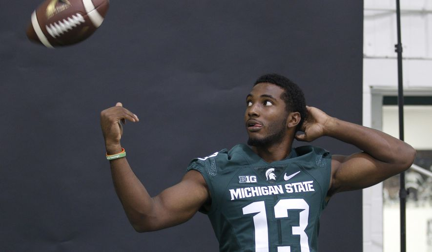 Michigan State cornerback Vayante Copeland tosses the ball during the team's NCAA college football media day, Monday, Aug. 8, 2016, in East Lansing, Mich. (AP Photo/Al Goldis)