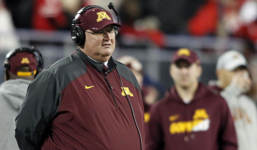 FILE - In this Nov. 7, 2015, file photo, Minnesota interim coach Tracy Claeys watches during an NCAA college football game against Ohio State in Columbus, Ohio. Claeys was named Minnesota's head coach on Nov. 11, 2015, succeeding his good friend Jerry Kill, who resigned his position on Oct. 28, 2015, due to health reasons. (AP Photo/Paul Vernon, File)