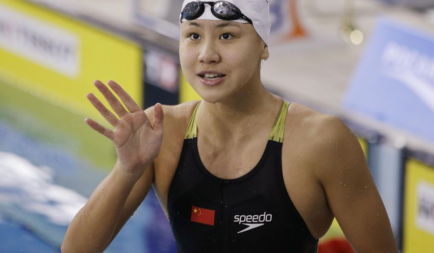 CORRECTS SLUG - FILE - In this Sept. 26, 2014 file photo, China's Chen Xinyi reacts after winning the women's 50m freestyle swimming final at the 17th Asian Games in Incheon, South Korea. The Chinese Swimming Association said Chen Xinyi tested positive for the substance without providing specifics. Xinhua, the official state news agency, reported the story early Friday, Aug. 12, 2016. (AP Photo/Lee Jin-man, File)
