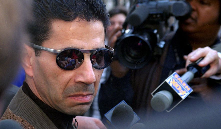 "FILE - In this Feb. 20, 1997 file photo, Joseph ""Skinny Joey"" Merlino talks to the media  outside the Criminal Justice Center in Philadelphia. U.S. Magistrate Judge William Matthewson ruled Friday, Aug. 12, 2016,  in West Palm Beach, Fla., that Merlino be released on house arrest and wear an ankle monitor.  Merlino is charged with allegedly taking part in a health care fraud scheme where conspirators got corrupt doctors to bill insurers for unnecessary prescriptions for expensive compound creams in exchange for kickbacks. (AP Photo/ H. Rumph, Jr.)"