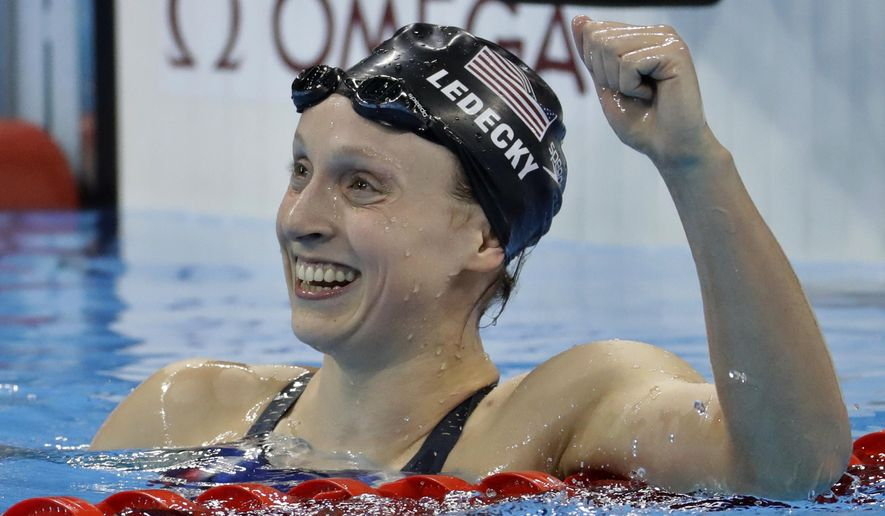 Unites States' Katie Ledecky celebrates after winning gold in the women's 800-meter freestyle final during the swimming competitions at the 2016 Summer Olympics, Friday, Aug. 12, 2016, in Rio de Janeiro, Brazil. (AP Photo/Julio Cortez)