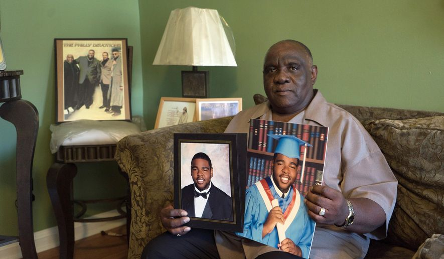 Retired bus driver Ellis Hill holds portraits of his son, Olympic shot putter and Penn State graduate Darrell Hill, on Thursday, Aug. 11, 2016, in his home in Darby, Pa. Philadelphia-area Uber driver Ellis Hill of Darby, Pa., was resigned to watching TV coverage of his son, shot putter Darrell Hill, competing in the Olympics on Thursday, Aug. 18, 2016, but passenger Liz Willock of Chicago raised more than $7,500 online in two days to send the retired bus driver to Brazil, his first trip outside the U.S. (AP Photo/Dake Kang)