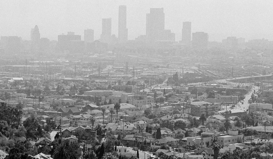 HOLD FOR STORY - FILE - In this July 15, 1978 file photo, a pall of smog lies over the Los Angeles skyline. Southern California is having its smoggiest summer in nearly a decade and hospitals report an increase of people with breathing problems. The South Coast Air Quality Management District says ozone levels exceeded federal standards for all but four days in June 2016. July had only one clean-air day, and there hasn't been a single day so far in August. The South Coast Air Quality Management District says even the worst smog is nothing compared to the foul blanket that used to cover Southern California in the 1970s. (AP Photo/Nick Ut, File)