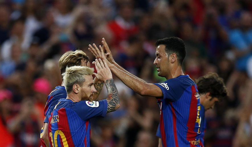 FC Barcelona's Lionel Messi, left, celebrates with teammates after scoring during the Joan Gamper trophy friendly soccer match between FC Barcelona and Sampdoria at the Camp Nou in Barcelona, Spain, Wednesday, Aug. 10, 2016. (AP Photo/Manu Fernandez)