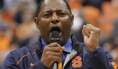 """FILE - In this Jan. 9, 2016, file photo, Syracuse's new head football coach Dino Babers addresses the crowd at the Carrier Dome during half time of an NCAA college basketball game Syracuse against North Carolina in Syracuse, N.Y. Babers hasn't made any bold promises, just a plea for fan support. """"We're not going to make promises, but if you have faith and fill this place ... you're going to see something you've never seen before,"""" Babers said in January to a Carrier Dome basketball crowd of over 27,000. (AP Photo/Nick Lisi, File)"""