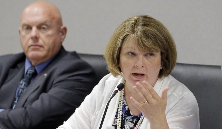 Utah State Board of Education Board member Linda Hansen, right speaks during Utah State Board of Education meeting Friday, Aug. 12, 2016, in Salt Lake City. Utah public schools facing a teacher shortage will be able to hire people without a teaching license or experience. Hansen said the shortage is so severe that a rural high school in the area she represents that badly needs a math teacher called colleges in a futile effort to find one and then started going through names of residents living nearby who have math expertise and might be able to teach. (AP Photo/Rick Bowmer)