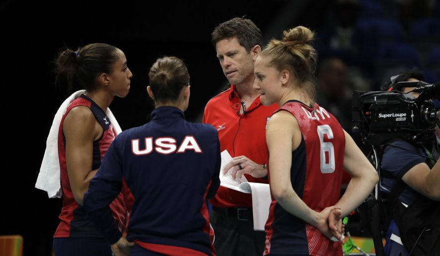 In this Wednesday, Aug. 10, 2016 photo, United States' Alisha Glass, left, Courtney Thompson, and Carli Lloyd, right, meet with assistant coach Tom Black during a women's preliminary volleyball match against Serbia at the 2016 Summer Olympics in Rio de Janeiro, Brazil. (AP Photo/Matt Rourke)