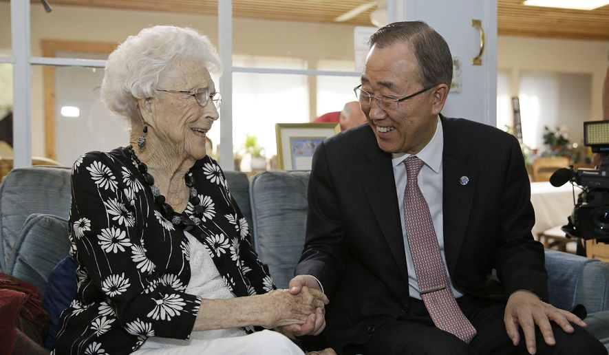 "U.N. Secretary-General Ban Ki-moon visits with his 99-year-old ""American Mom"" Libba Patterson before lunch at her home Thursday, Aug. 11, 2016, in Novato, Calif. The two became acquainted when Patterson and her family hosted the future UN chief on his first trip to the United States, when he was 18. Patterson had tears in her eyes when she spoke about how the teenage ""Ki-moon"" became her fourth child and part of her family during his eight-day visit in 1962. When Ban is on the west coast he tries to visit Patterson at her home north of San Francisco. (AP Photo/Eric Risberg)"