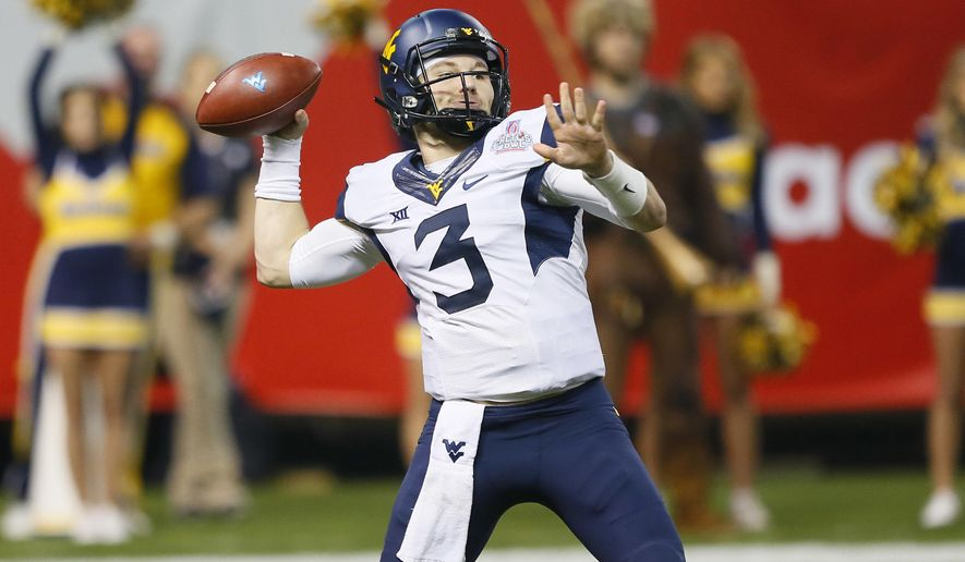 FILE - In this Jan. 2, 2016, file photo, West Virginia quarterback Skyler Howard (3) throws against Arizona State during the first half of the Cactus Bowl NCAA college football game, in Phoenix.  Skyler Howard will try to feed off the momentum of last year's Cactus Bowl, when he threw for a bowl-record 532 yards and five touchdowns in a 43-42 win over Arizona State. (AP Photo/Matt York, File)