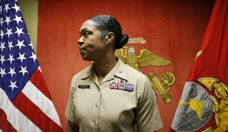 In this Aug. 5, 2016 photo, Maj. Shanelle Porter, commanding officer at the Recruiting Station Chicago stands outside her office in Des Plaines, Ill. The U.S. Marine Corps is looking for a few more good women. And this time the campaigns a bit different. Marine recruiters are turning to girls high school sports teams to find candidates who may be able to meet the Corps rigorous physical standards _ including for front-line combat jobs now open to women. Porter said most women coming in the door just want to be Marines, but so far two women have said they were looking for front-line roles. The women, she said, want to be pioneers.  (AP Photo/Tae-Gyun Kim)