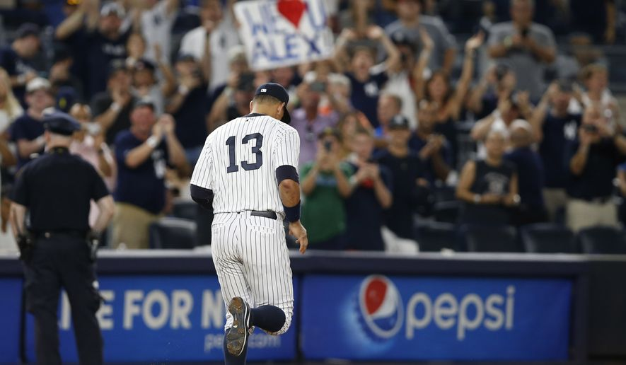 Fans applaud and hold signs as New York Yankees Alex Rodriguez (13) takes his position at third base in the ninth inning of his final game as a Yankee player, against the Tampa Bay Rays at Yankee Stadium in New York, Friday, Aug. 12, 2016. The Yankees won 6-3. (AP Photo/Kathy Willens)