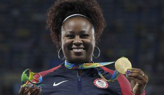 United States' Michelle Carter celebrates winning the gold medal in the women's shot put during the athletics competitions of the 2016 Summer Olympics at the Olympic stadium in Rio de Janeiro, Brazil, Saturday, Aug. 13, 2016. (AP Photo/Kirsty Wigglesworth)