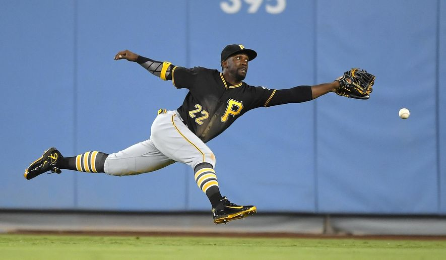Pittsburgh Pirates center fielder Andrew McCutchen can't reach a ball hit for a double by Los Angeles Dodgers' Adrian Gonzalez during the sixth inning of a baseball game, Friday, Aug. 12, 2016, in Los Angeles. (AP Photo/Mark J. Terrill)