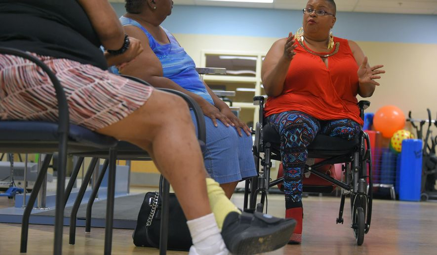 In this photo taken July 20, 2016, Angela Manning, right, wearing a high heel at the University of Maryland rehabilitation center in Baltimore, hopes that some day prosthetic limbs may be designed with the ability to wear high heels. (Karl Merton Ferron/The Baltimore Sun via AP)