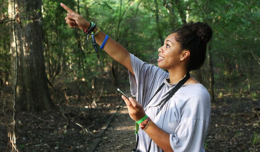 Iriel Edwards points to a red-eyed vireo during a walk along the swamp trail at Black Bayou National Wildlife Refuge on the morning of Friday, July 8, 2016. Edwards has identified red-eyed vireos by sight and sound before. Later than morning, she heard a white-eyed vireo, which she has not yet seen, though she has heard them before. (Hannah Baldwin/Monroe News Star via AP)