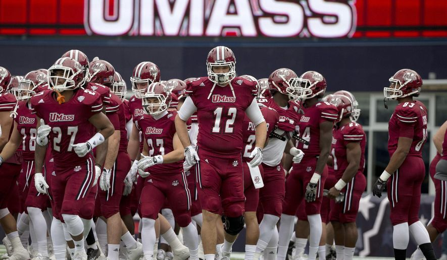 FILE - In this Nov. 7, 2015 file photo Massachusetts tight end Todd Stafford (12) and teammates warm up before an NCAA college football game against Akron in Foxborough, Mass. UMass will be playing as an independent during the 2016 college football season since essentially being booted out of the Mid-American Conference. (AP Photo/Michael Dwyer, File)
