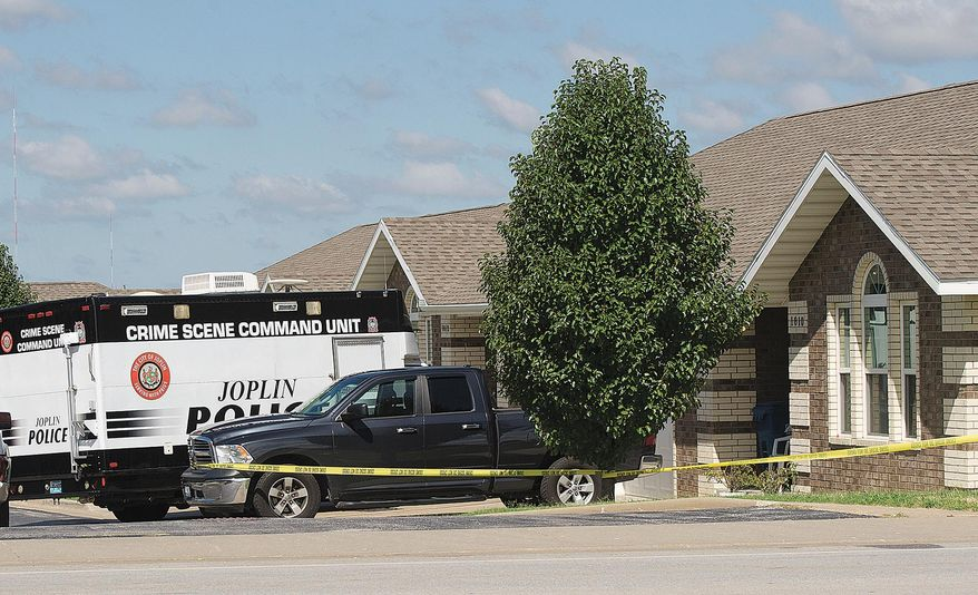 Joplin Police investigate the scene of a reported early morning shooting on Saturday, Aug. 13, 2016, near 20th and Connecticut streets in Joplin, Mo. Police received a call about a possible shooting at this residence around 5 a.m. Saturday. A suspect was arrested after an early morning shooting spree that injured five people and two service-dogs. (Laurie Sisk /The Joplin Globe via AP)