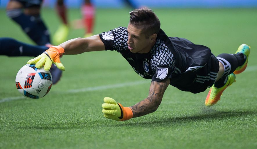 San Jose Earthquakes goalkeeper David Bingham dives to make a save against the Vancouver Whitecaps during the first half of an MLS soccer match in Vancouver, British Columbia, on Friday, Aug. 12, 2016. (Darryl Dyck/The Canadian Press via AP)