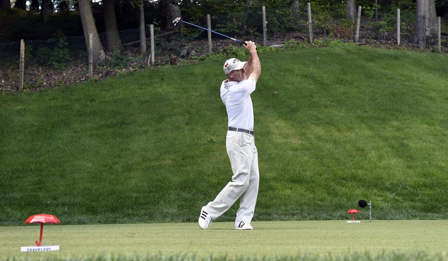 FILE - In this Aug. 7, 2016 photo, Jim Furyk tees off on the 15th hole during the final round of the Travelers Championship golf tournament in Cromwell, Conn. PGA Tour commissioner Tim Finchem said the PGA would build a 32,000-square foot clubhouse at the course to open before the pros tee off at the course in 2019. The course made international headlines when Furyk shot a 58 during final round, the lowest score in tour history. (AP Photo/Fred Beckham)