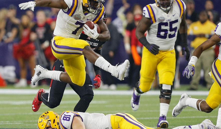 FILE - In this Dec. 29, 2015, file photo, LSU running back Leonard Fournette (7) hurdles tight end Colin Jeter (81) as he rushes against Texas Tech during the first half of the Texas Bowl NCAA college football game in Houston. It's another year of the running back in college football. Fournette, Stanford's Christian McCaffrey, Oregon's Royce Freeman and Florida State's Dalvin Cook all are back after rushing for over 1,800 yards last season. (AP Photo/Bob Levey, File)