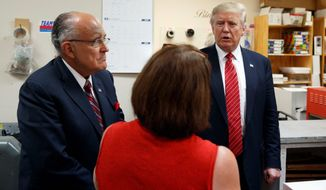 A congressional source said former New York Mayor Rudolph W. Giuliani had emerged as Donald Trump's point man for trying to persuade Republican lawmakers with key national security committee positions to publicly say they were advising the campaign. (Associated Press)