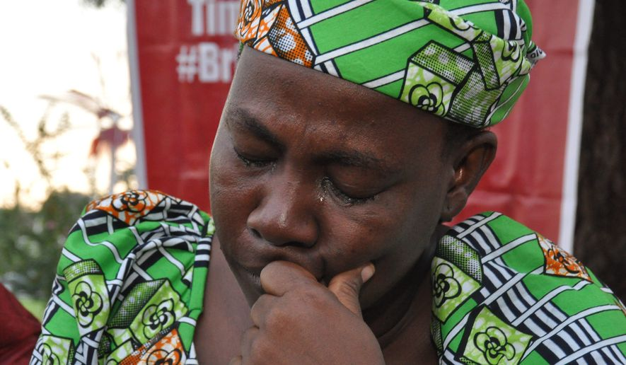 Esther Yakubu, mother of one of the kidnapped school girls, cries out after she saw her daughter in a video released by Boko Haram during a briefing in Abuja, Nigeria. Sunday, Aug. 14, 2016. (AP Photo/Olamikan Gbemiga) ** FILE **