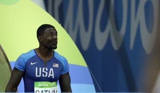 United States' Justin Gatlin makes a face as he is booed when entering the stadium for the men's 100-meter final during the athletics competitions of the 2016 Summer Olympics at the Olympic stadium in Rio de Janeiro, Brazil, Sunday, Aug. 14, 2016. (AP Photo/Matt Dunham)